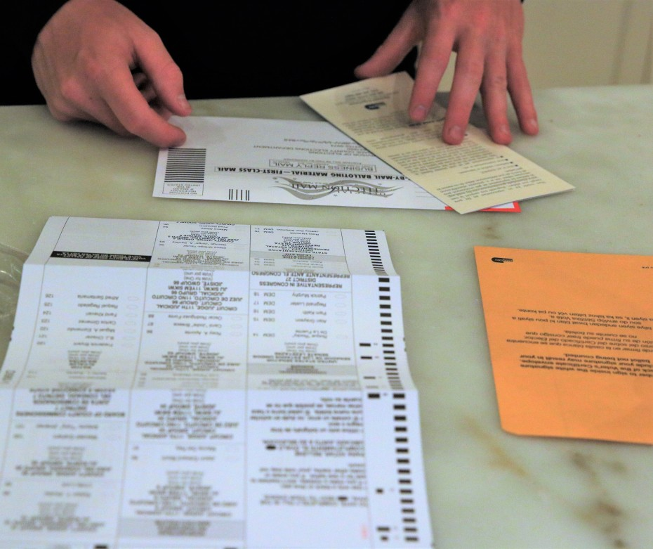 Person filling out mail-in ballot
