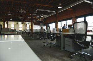 Mostly empty modern office with tables and chairs.