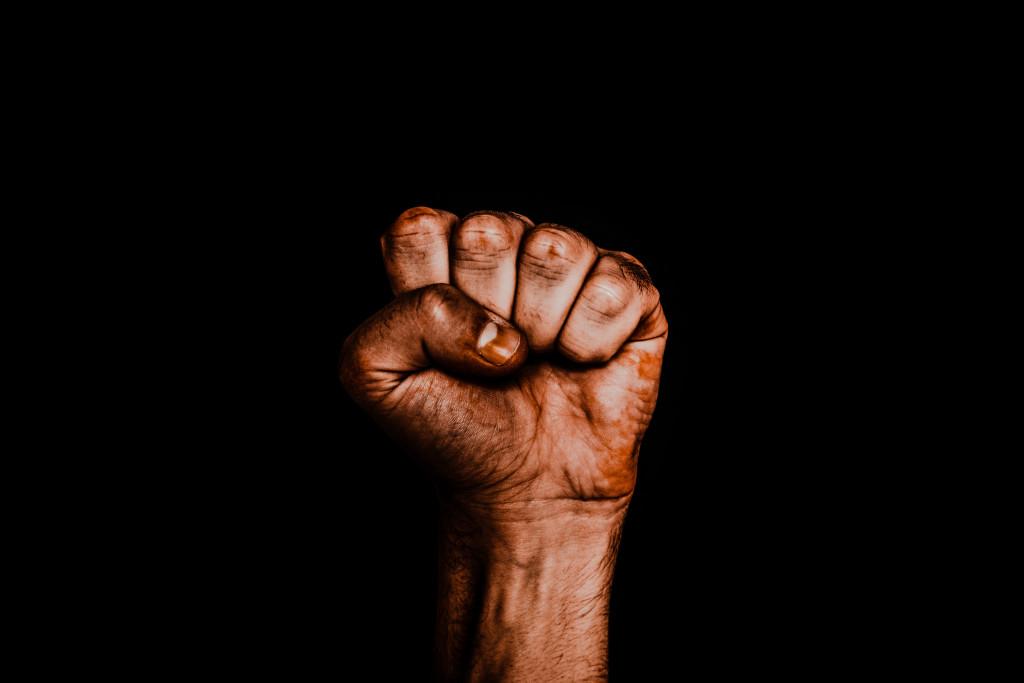 Black Lives Matter. Black fist clenched