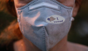 """I Voted"" Sticker on Mask during coronavirus"