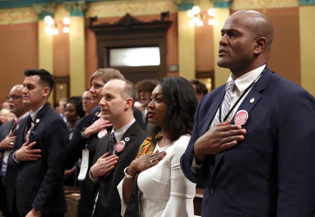 A diverse crowd of state legislators take oath