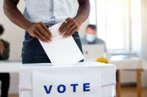 African-american man putting his vote in the ballot box