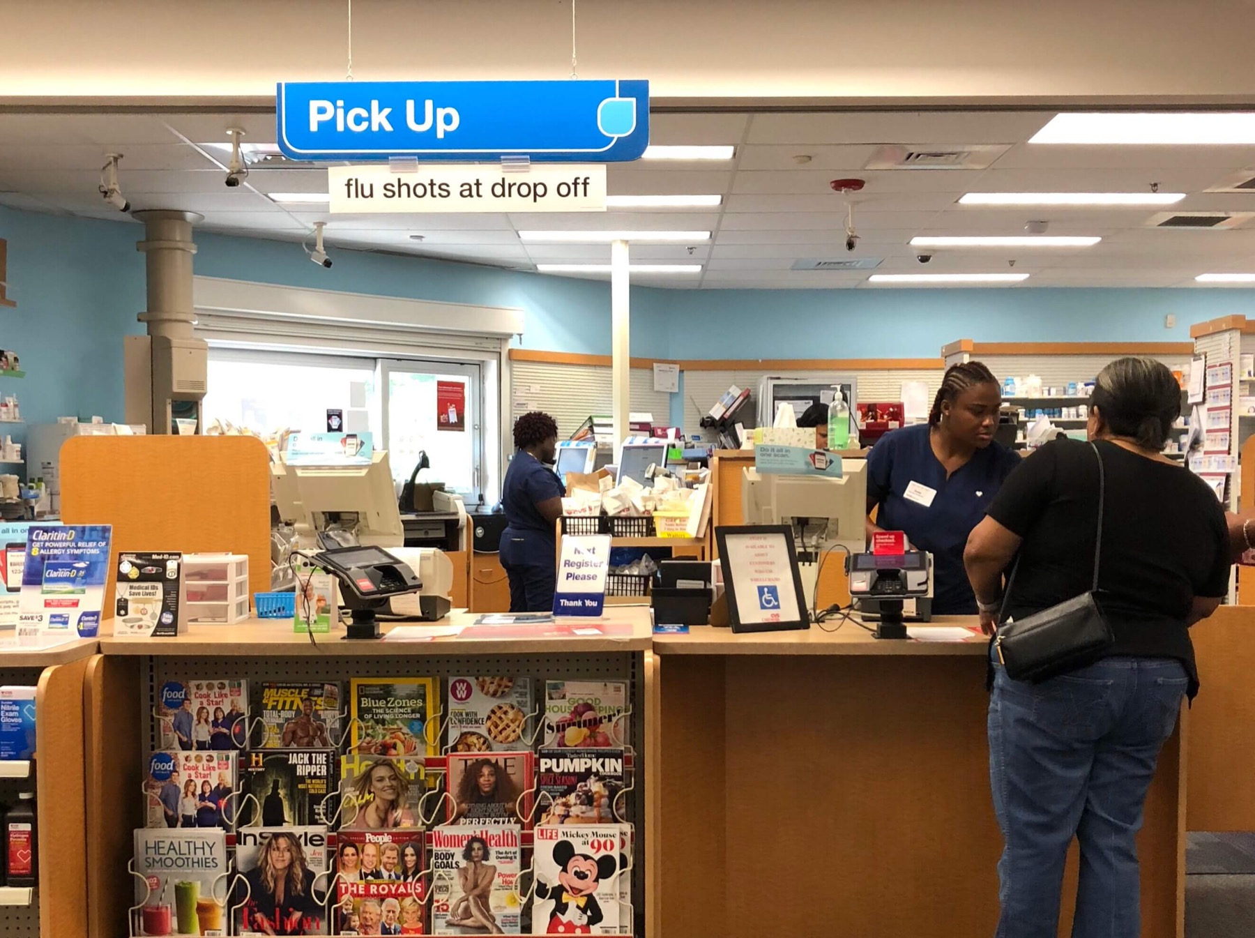 Pharmacist and customer interacting at a retail pharmacy