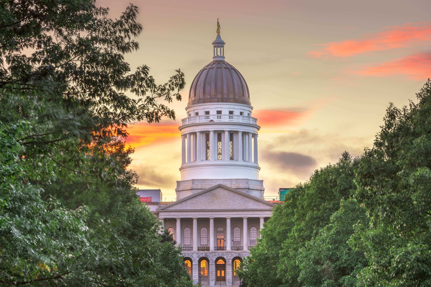 Exterior of the maine state capitol building at dusk