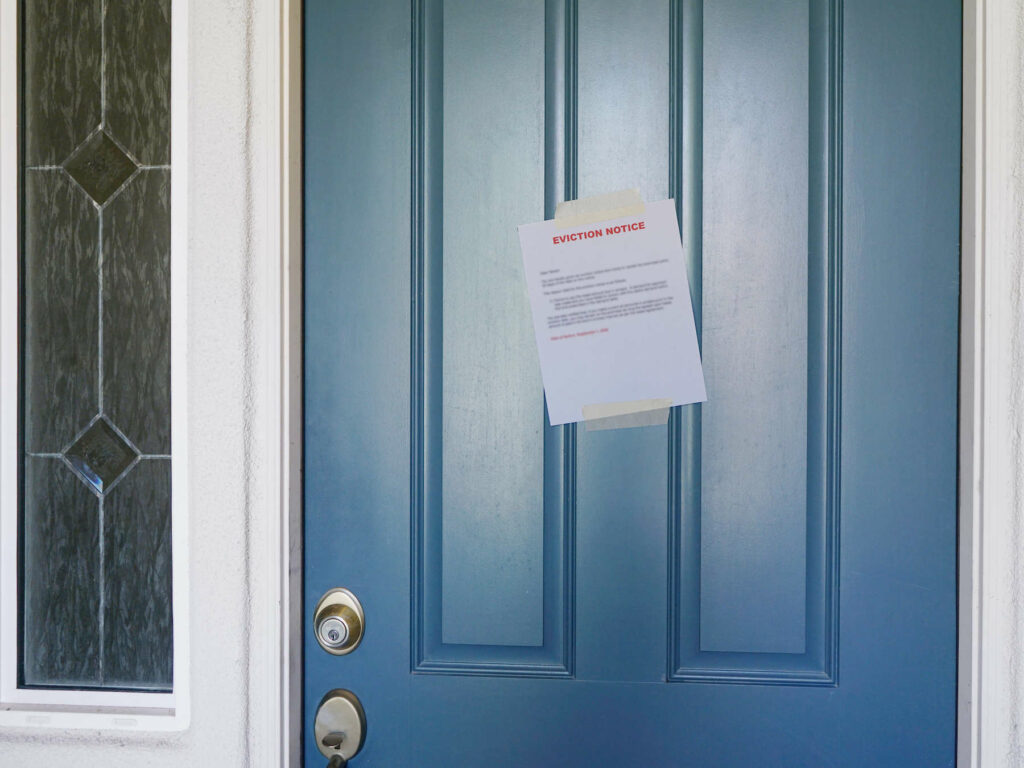 An eviction notice taped to the front door of a home