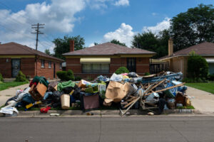 Eviction scene; Belongings from house are on the curb