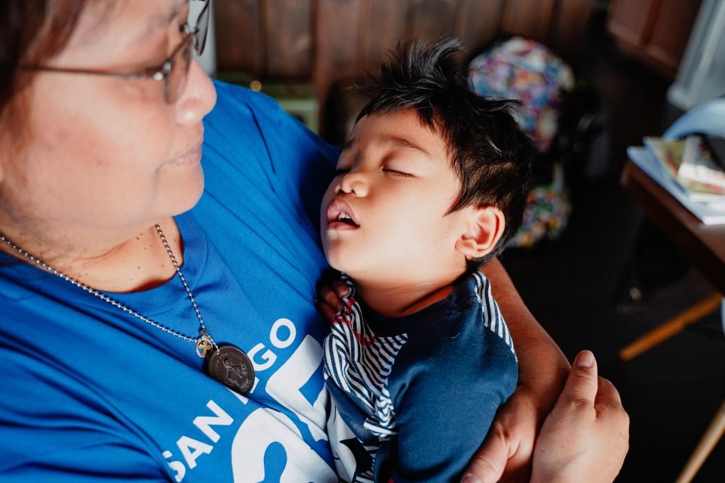 Grandma grandmother grandparent diverse baby boomer taking care of sleeping sleep sick i ll grandson t20 rz8rgw