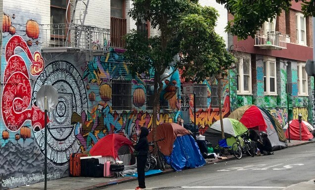 Tents alongside a mural in san francisco
