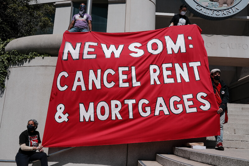 "Activists rally for the #cancelrent movement; sign reads: ""newsom cancel rent and mortgages"""