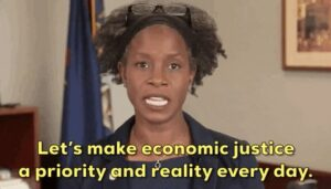 "Sen. Erika geiss gif with subtitle ""let's make economic justice a priority and reality every day. """