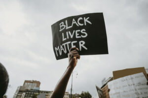 "Holding sign that reads, ""black lives matter"""