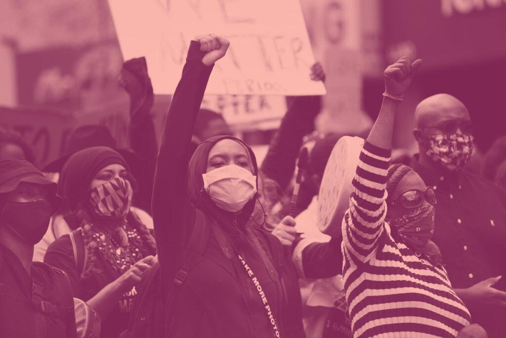 Black women with raised fists at protest