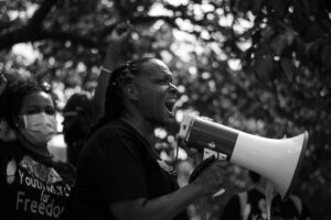Rep. Attica scott participates in youth led peaceful protest marching in downtown louisville kentucky 7/4/2020