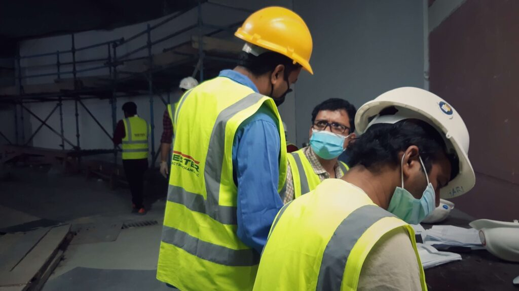 Masked construction workers in conversation