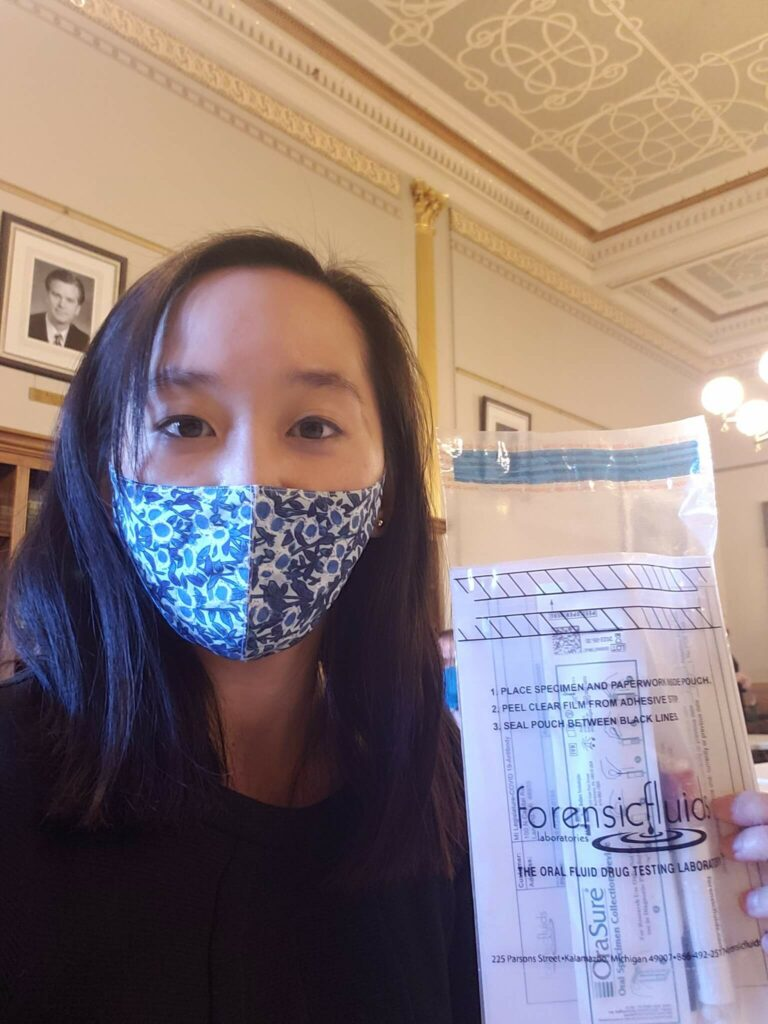 Michigan state senator stephanie chang with covid-19 test kit in the michigan state capitol