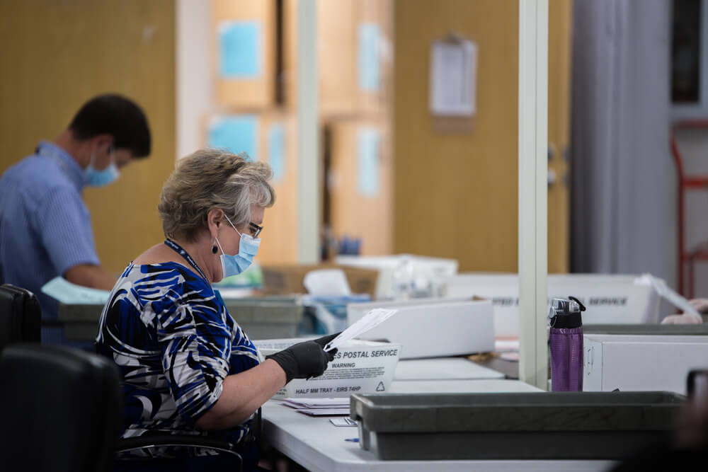 Election poll workers wear masks during the primary election day in nevada