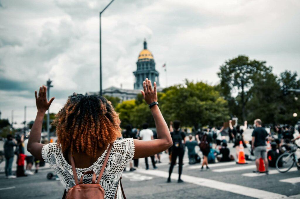 Colin lloyd hands raised colorado state capitol