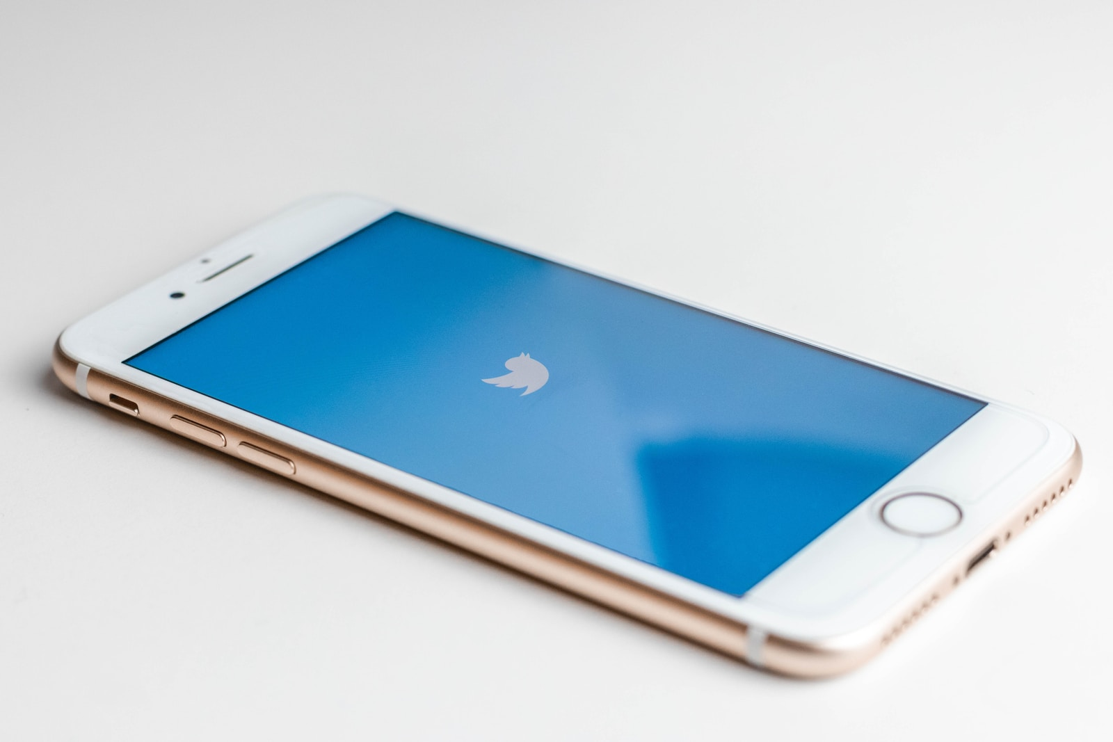 Gold iphone 6s with twitter logo on screen