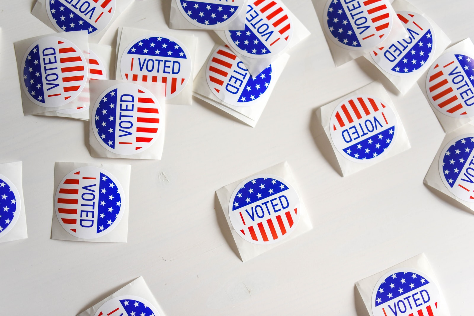 """Pile of """"voted"""" stickers with american flag"""