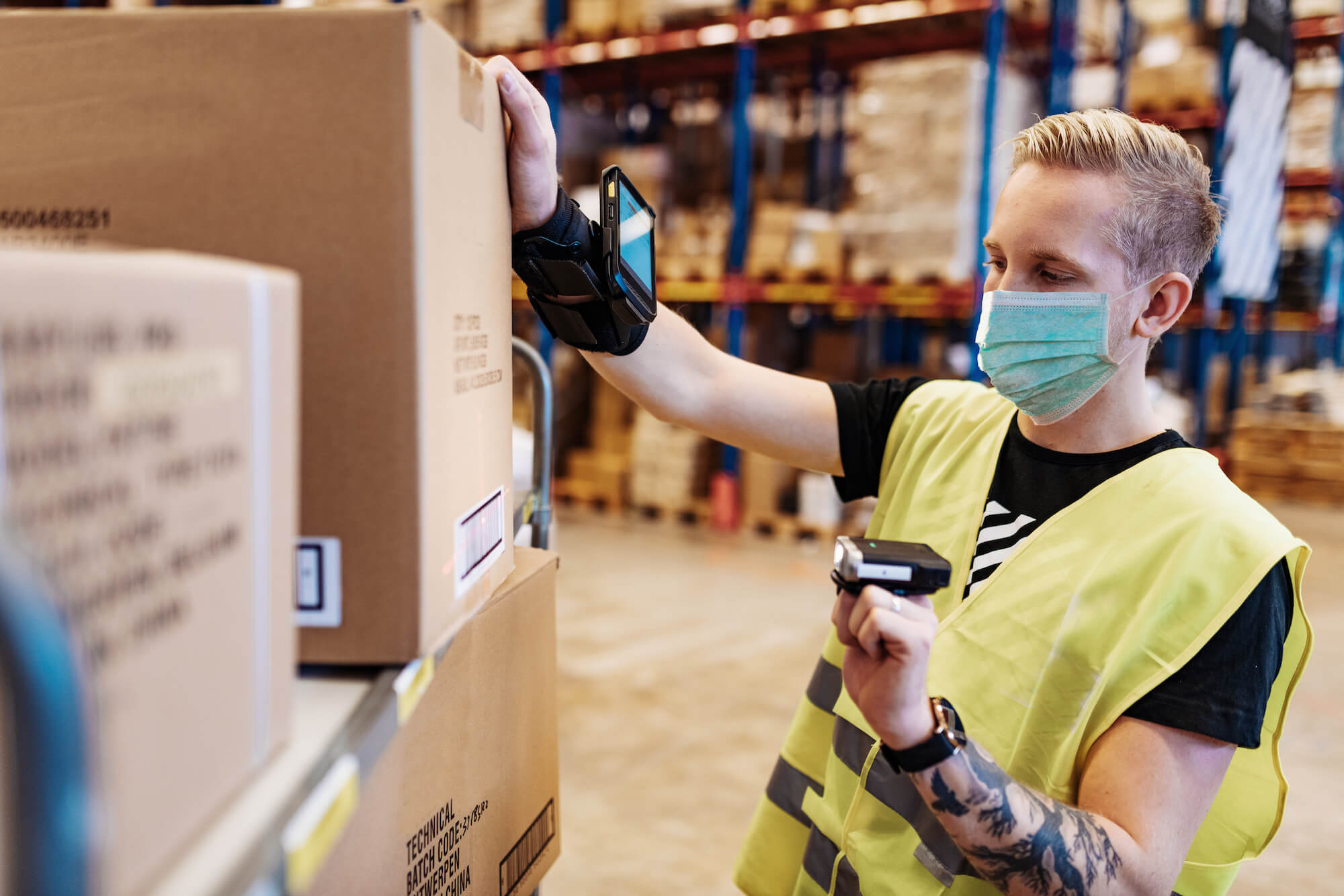 Tattooed white essential workers in service and delivery industry with face mask during covid pandemic