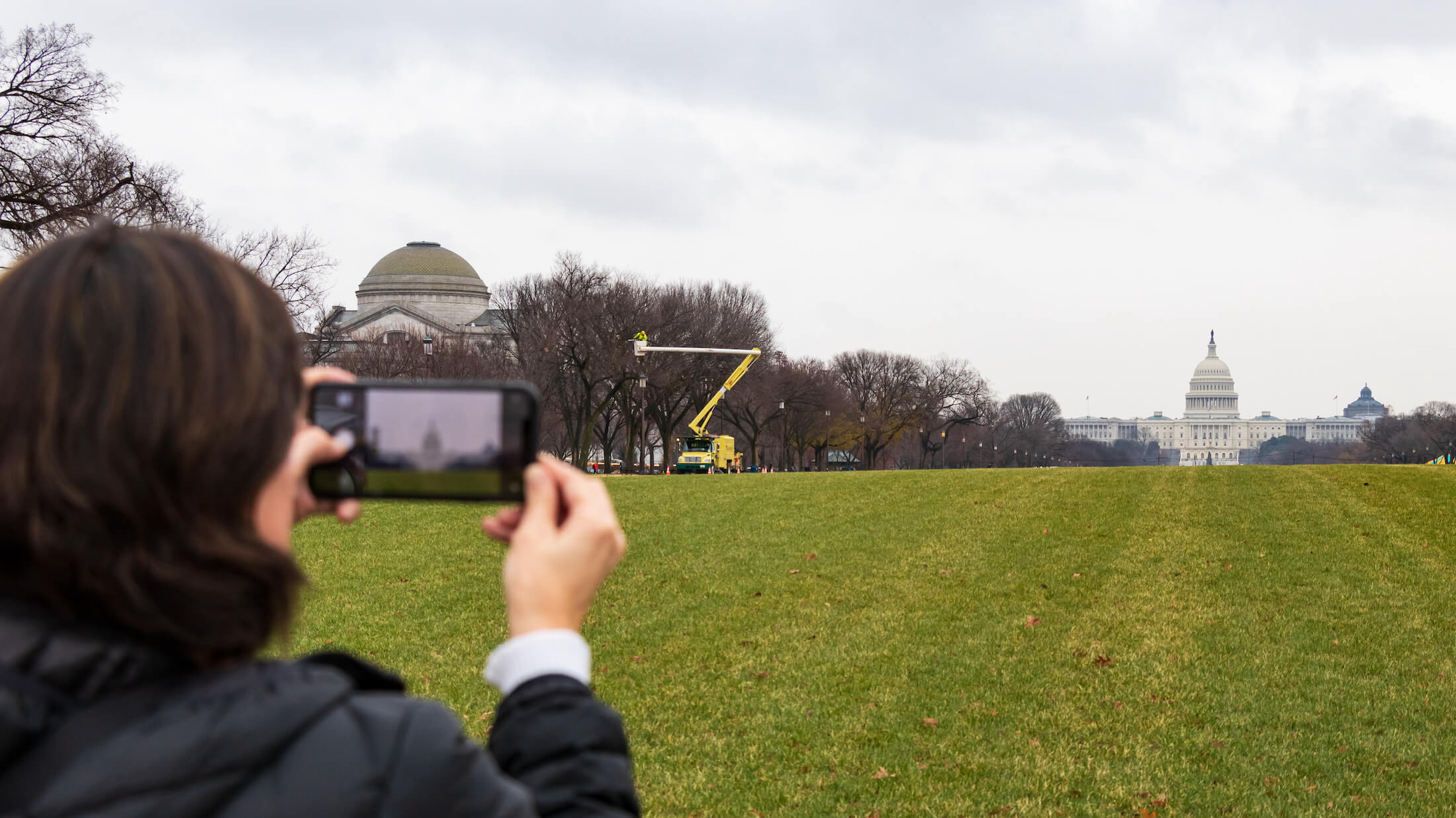 Person taking picture of capitol with phone