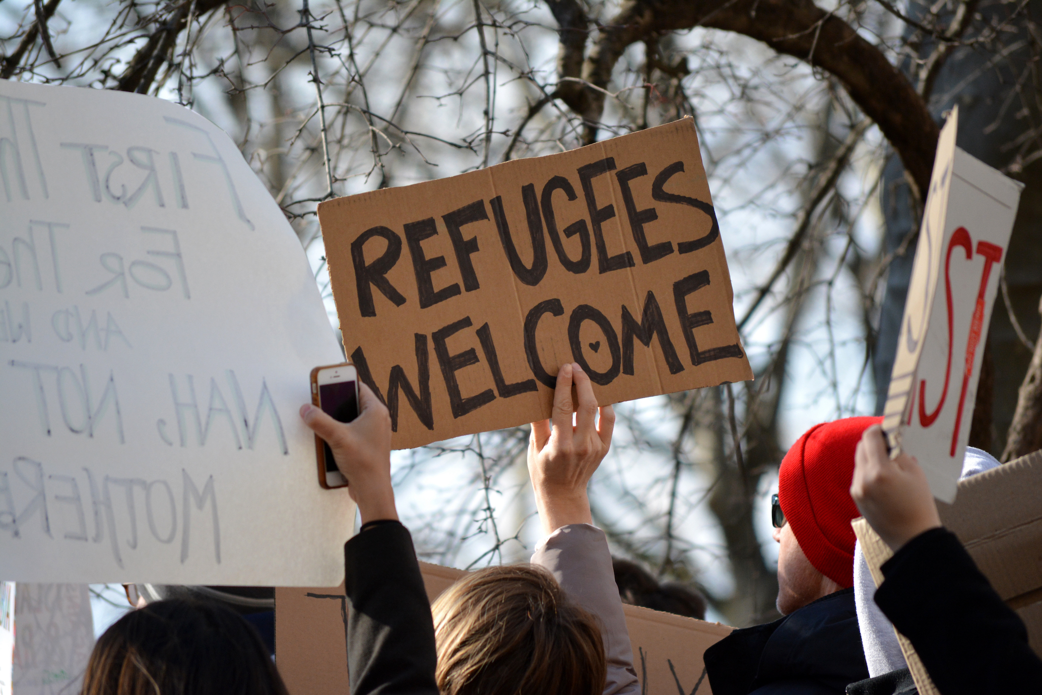 """Rally sign reads """"refugees welcome"""""""