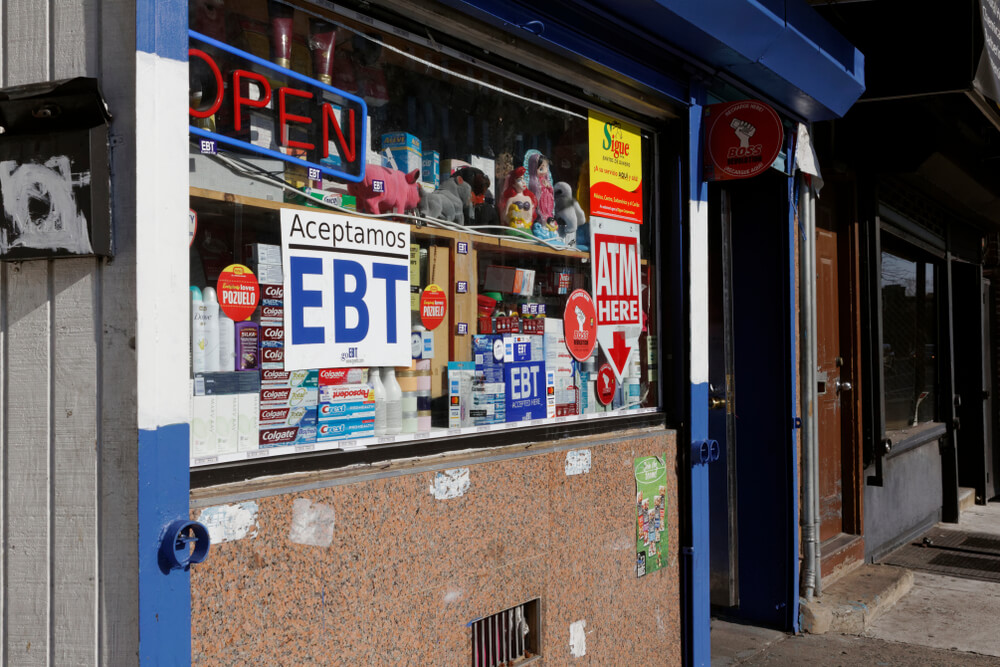 """Exterior of convenience store in philadelphia; signs read """"ebt aceptamos"""" and """"atm here"""" jana shea / shutterstock. Com"""